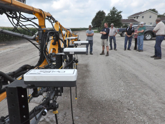 People look over optical sensing technology on a high-clearance sprayer at a University of Nebraska-Lincoln (UNL) Project Sensors for Efficient Nitrogen Use and Stewardship of the Environment (SENSE) field day near Schuyler, Nebraska, on Aug. 7. (DTN photo by Russ Quinn)