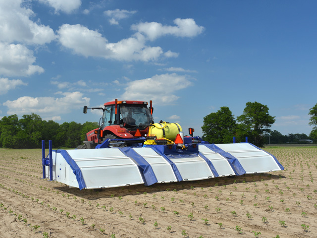 A See and Spray prototype works in a Marianna, Arkansas, cotton field. (Photo courtesy of Blue River Technology)