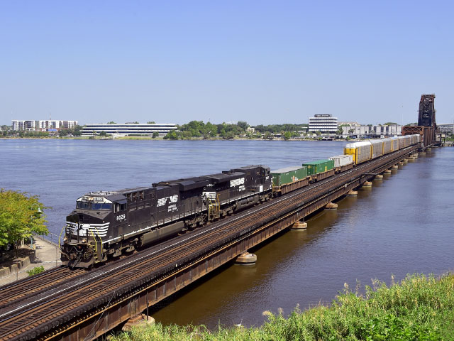 A Norfolk Southern train crosses the St. Johns River in Jacksonville, Florida. Norfolk Southern is now in recovery mode from the damage left behind by Hurricane Irma. The company is working nonstop with customers to identify switching needs and service plans as recovery progresses. (Photo courtesy of Norfolk Southern)