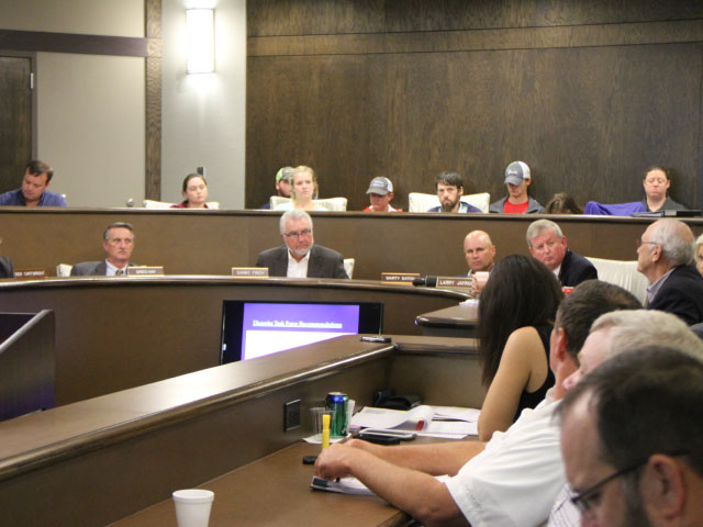 The Arkansas State Plant Board will contemplate serious restrictions on dicamba Wednesday at a hearing that is expected to draw many voices. The Pesticide Committee of the Plant Board is shown meeting in September. (DTN photo by Pamela Smith)