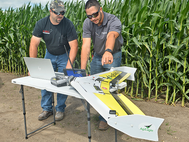 Randy Jax (left) and Herb Dowse, an ag precision specialist with Northern Country Co-op, discuss images taken with an AgEagle. (DTN/Progressive Farmer image by Bob Elbert)