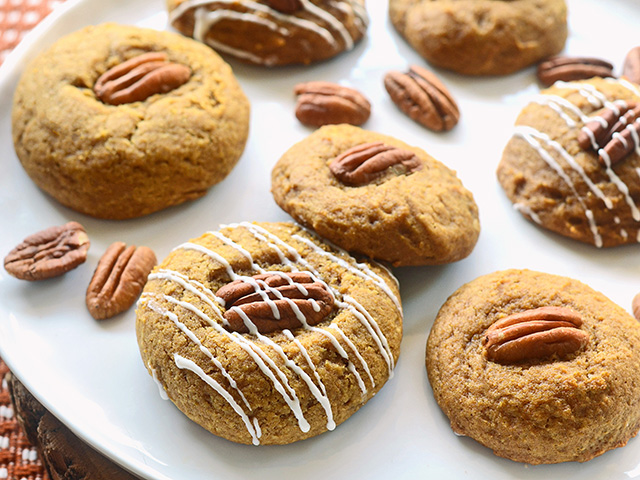 Soft, cakelike pumpkin cookies are topped with a pecan and drizzled with icing for extra sweetness. (DTN/Progressive Farmer image by Rachel Johnson)