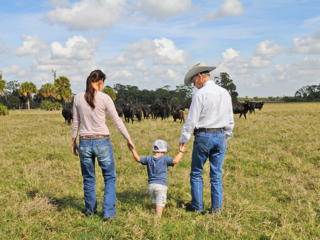 Ralph Pelaez (right) and daughter, Stephanie Pelaez Fowler, believe a focus on profits helps keep a ranch sustainable for the next generation, in this case, McKinley.(Progressive Farmer photo by Becky Mills)