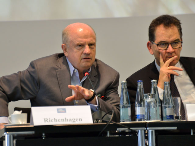 AGCO head Martin Richenhagen (left) told a conference at Agritechnica that Africa can become a breadbasket for the world. Gerd Muller, German federal minister for economic cooperation and development, is at right. (DTN/The Progressive Farmer photo by Jim Patrico)