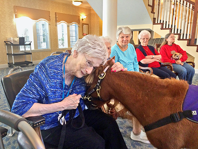 This little pony gets a big hug from Claudine Nichols, a resident at Imboden Creek Living Center, Decatur, Illinois. (DTN/The Progressive Farmer photo by Pamela Smith)