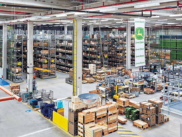 The European Parts Distribution Center in Bruchsal covers 26 acres and serves Europe, North America and beyond. Robots control the storage, picking and processing. (Photo courtesy of John Deere)