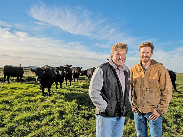 Gary Knutson (left) and son Kyle switched their 120-head herd entirely to grass and hay in 2011. They believe the all-forage diet has improved rumen health. (DTN/Progressive Farmer photo by Greg Latza)