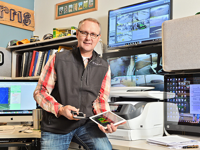 Steve Anderson, Beaman, Iowa, uses an iPhone and four iPads to monitor weather stations, drone software, home security, farm publications and weather data on various fields, as well as other farm-management operations. (Progressive Farmer photo by Bob Elbert)