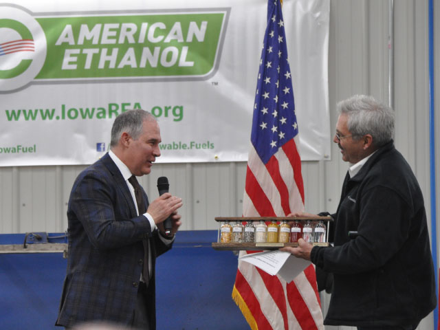 Iowa farmer, livestock producer and American Coalition for Ethanol member Bill Couser (right), presents EPA Administrator Scott Pruitt with a plaque showing the stages of ethanol production during at an event near Nevada, Iowa, on Friday. (DTN photo by Chris Clayton)