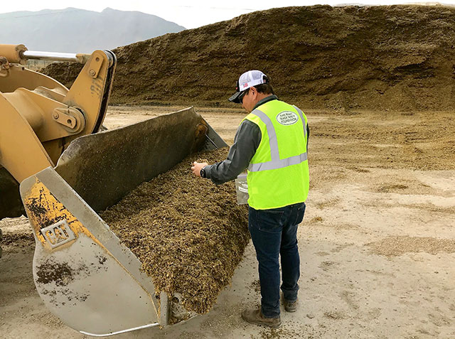 Keith and Ruthie Bolsen's mission is to promote safe silage practices, such as taking samples from a loader bucket a safe distance from the feedout face of the silage pile. (Image courtesy Keith Bolsen Silage Safety Foundation)