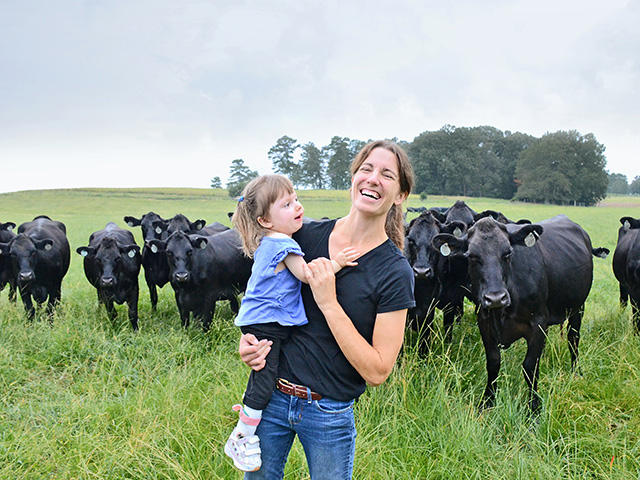 Jamie Blythe, with daughter Gracie, raises cattle in addition to cotton and corn crops in northern Alabama.(Progressive Farmer photo by Brent Warren)