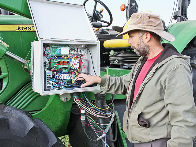 Kyler Laird's controller box on his John Deere 6330 manages multiple functions, including engine cutoff, throttle, steering, reverse and hitch. (DTN/The Progressive Farmer photo by Des Keller)