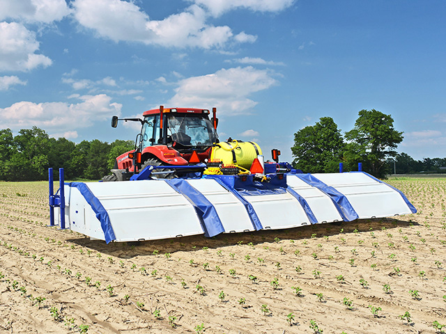 The See & Spray hooded sprayer recognizes green growth that is not a crop then sprays it with herbicide. (Photo courtesy of Blue River Technology)