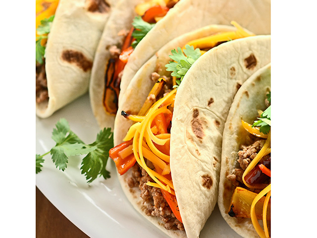 Taco night doesn't always have to be the same ol' recipe. Jazz up this weeknight standard by substituting lean ground turkey for beef and adding blistered sweet peppers. (DTN/Progressive Farmer image by Rachel Johnson)