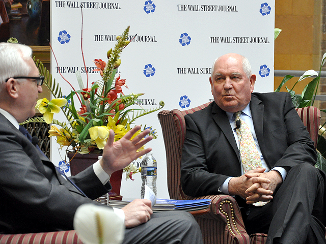Agriculture Secretary Sonny Perdue, right, spoke in a question-and-answer forum Wednesday at the USDA headquarters at an event sponsored by the Wall Street Journal. Paul Gigot, editorial page editor for the WSJ, questioned Perdue on trade and regulatory issues. (DTN photo by Chris Clayton)