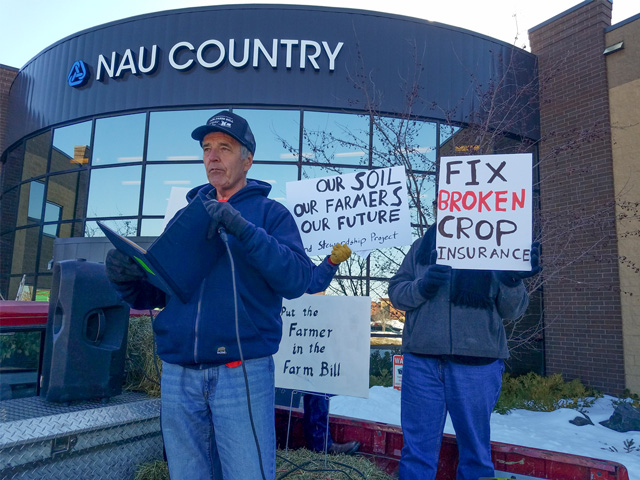 Randy Krzmarzick, a farmer from Sleepy Eye, Minn., speaks Monday on crop insurance reforms outside of NAU Country's headquarters in Minnesota. (courtesy photo)