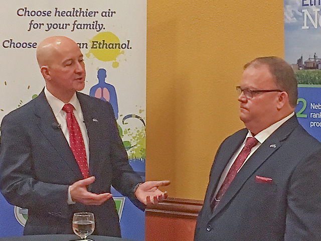 Nebraska Gov. Pete Ricketts (left) and Jan tenBensel, chairman of the Nebraska Ethanol Board, talk about E15 and President Donald Trump at a conference Friday in LaVista, Nebraska. (DTN photo by Chris Clayton)