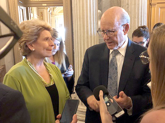 Sen. Debbie Stabenow (left) and Sen. Pat Roberts talk to reporters after the Senate passed its version of the farm bill Thursday. (DTN photo by Chris Clayton)