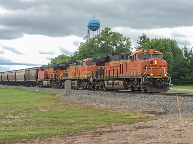 BNSF completed the installation of all mandated positive train control (PTC) infrastructure at the end of 2017, including 88 required subdivisions covering more than 11,500 route miles on its network. Pictured is a BNSF train moving through Randall, Minnesota, along the Northern Trans Con. (Photo by Mary Kennedy)
