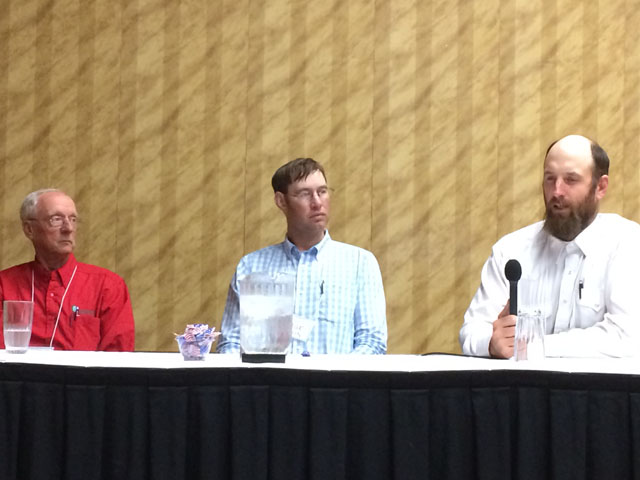 During a panel discussion at the 2018 Nebraska Grazing Conference held in Kearney, Nebraska, this week, ranchers who graze multiple species discuss their experiences with conference attendees. From left to right are Mike Wallace, Sage Askin and Brock Terrell. (DTN photo by Russ Quinn)
