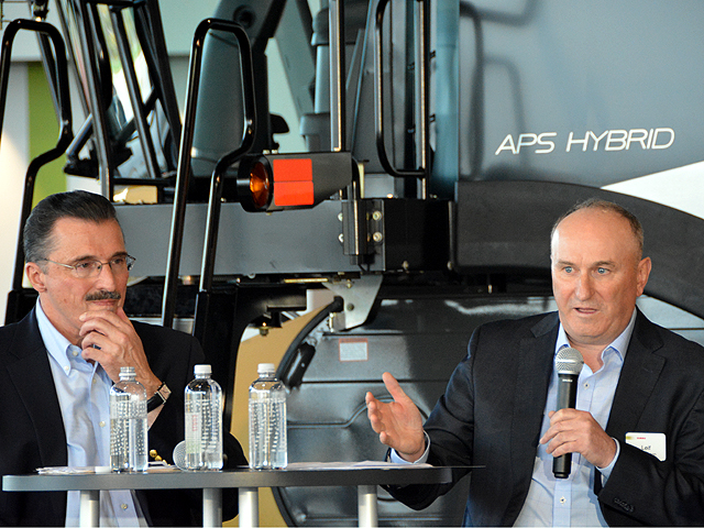Dennis Slater (left), president of the Association of Equipment Manufacturers, and Leif Magnusson, president of CLAAS Global Sales America Inc., talk about trade, tariffs and infrastructure at a roundtable discussion Tuesday at CLAAS' headquarters for North American operations in Omaha. (DTN photo by Chris Clayton)