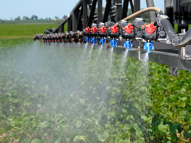 The new dicamba regulations will limit over-the-top dicamba applications on soybean fields to 45 days post-plant. (Photo courtesy of TeeJet)