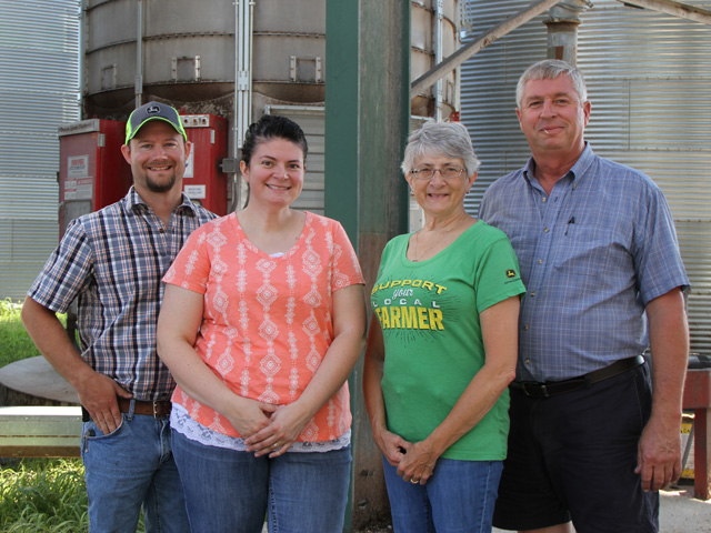 Reporting from Ohio, Genny Haun (center) has allowed readers a look at farming life. She farms with her husband, Matt (left), and her parents, Cindy and Jan Layman. (DTN photo by Pamela Smith)