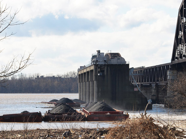 Barges are stacked up against the McAlpine Dam on the Ohio River after an accident occurred on Dec. 25. Seven of those barges eventually sunk. (USACE photo by Katie Newton)