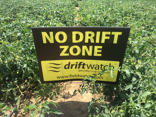 A FieldWatch sign alerts pesticide applicators to tomatoes in an Indiana field. Farmers and spray applicators also have access to an online registry to identify sensitive crops as more growers seek protection from dicamba injury. (Photos by Pamela Smith)