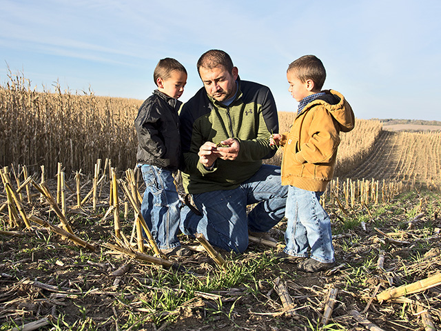 Kevin Ross is taking steps today to use practices that improve his land in hopes that one or all of his four sons (shown, Carver and Hollis) will want to take over the family farm. (DTN/The Progressive Farmer photo by Greg Lamp)