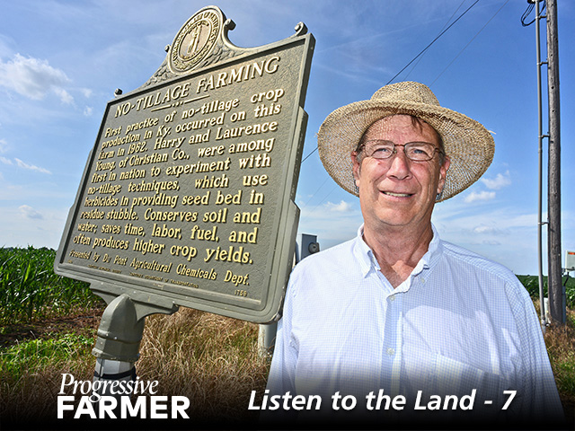John Young stands with a historical marker highlighting his family-farm's distinction of being an early no-till adopter. (DTN/Progressive Farmer photo by Charles Johnson)