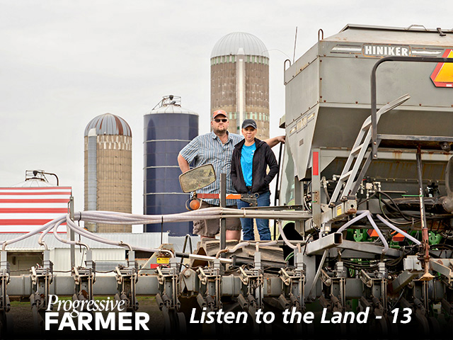 Loran Steinlage stands with his wife, Brenda, on his home-built cover-crop interseeder. (Photo by Northeast Iowa Resource Conservation and Development and Jessica Rilling)