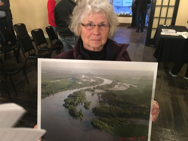 Tekamah, Nebraska, farmer Donette Jackson holds a picture of the Missouri River flooding near her land. (Photo by Todd Neeley)