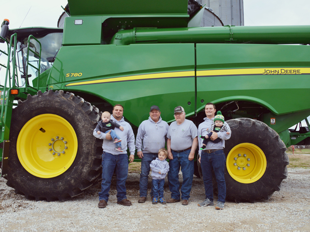 Four generations of family care for Wallis Farms. From left to right, son-in-law Brad Winter holds son, Ben Winter; Scott Wallis, Bob Wallis, J.R. Wallis holds Bobby Joe Wallis. Henry Winter in the front row. (Photo courtesy of Nikki Wallis)