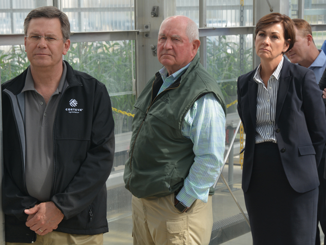 (From left to right) Jim Collins, CEO-elect of Corteva Agriscience, U.S. Secretary of Agriculture Sonny Perdue and Iowa Gov. Kim Reynolds listen as Corteva researchers talk about seed technology Monday at the Mendel Greenhouse Complex in Johnston, Iowa. (DTN/Progressive Farmer photo by Matt Wilde)