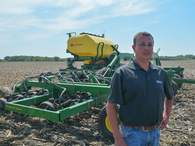 Tony Douglas, manager of AgriVision Equipment Group's Lenox, Iowa, location, is providing field demonstrations of John Deere's new N542C grain drill to customers before the air seeder goes into production in June. (DTN/Progressive Farmer photo by Matthew Wilde)