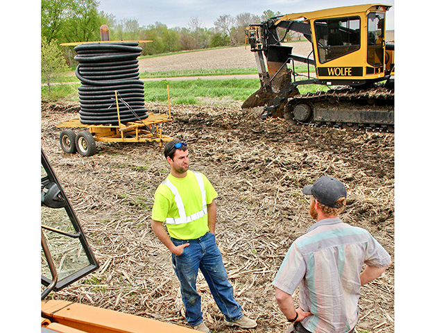 Brothers Jacob, left, and Brian Handsaker diversified their operation with excavation and drainage tile work, Image by Des Keller