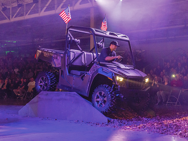 Country music star Luke Bryan drives a Tracker Off Road side-by-side during a dealer and employee launch event, Image provided by the manufacturer