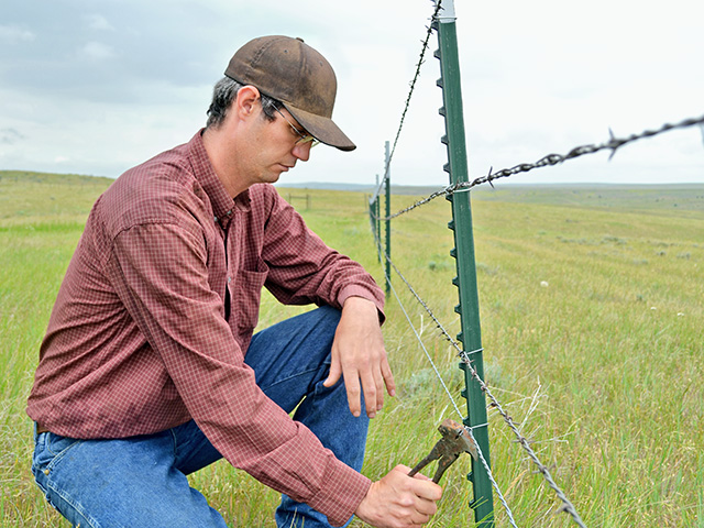 Myles Gardner says he couldn't be a rancher without his fencing business, which provides the family an important source of income, Image by Robert Waggener