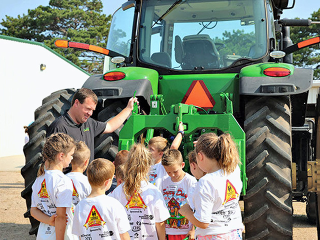 The three most common causes of ag-related injuries among children are falls, animals and machinery, such as tractors, according to Youth Agricultural Safety Specialist Marsha Salzwedel. (Photo courtesy of Progressive Agriculture Foundation)