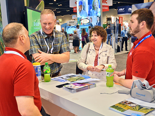 BASF representatives discuss the company's new products with Iowa farmers Joe and Suzanne Shirbroun, Image by Matthew Wilde