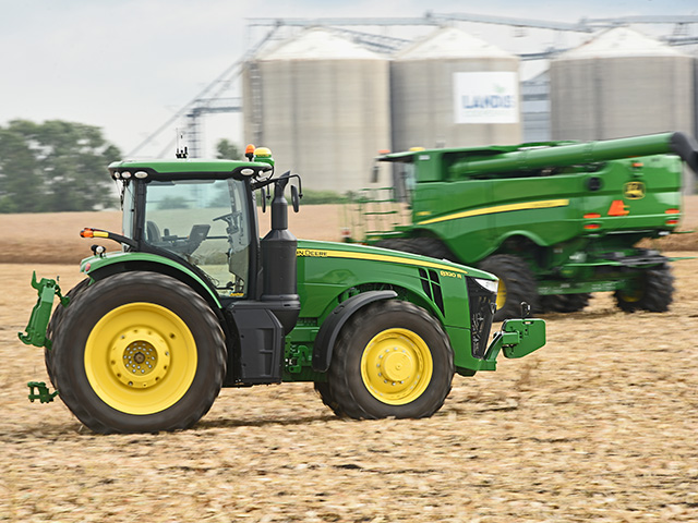 A John Deere 8320R runs autonomously along with other unmanned big hardware at the 2018 Farm Progress Show, Image by Joel Reichenberger
