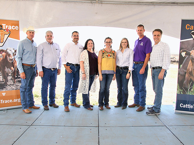 The Cattle Trace steering committee includes (left to right) Matt Teagarden, chief executive officer of Kansas Livestock Association; Justin Smith, animal health commissioner; Brandon Depenbusch, vice president of cattle operations for Innovative Livestock Services; Jackie McClaskey, secretary of agriculture; Mary Soukup, assistant secretary, Kansas Department of Agriculture; Cassandra Kniebel, project director, Cattle Trace; Brad White, director of The Beef Cattle Institute at Kansas State University; and Kansas Governor Jeff Colyer, Image Courtesy of Kansas Department of Agriculture