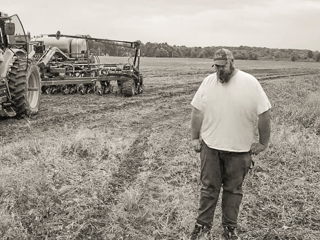 Farmer Sara Grier of Canfield, Ohio, posted this picture of her husband Wayne on social media to help share the stress her family has been going through this spring. Tens of thousands of people responded. (Photo courtesy of Sara Grier)