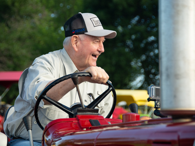 Agriculture Secretary Sonny Perdue prepares Monday morning to kick off the 23rd annual Great Iowa Tractor Ride. Perdue drove an International Harvester 656 tractor that his father had owned. (DTN photo by Chris Clayton)