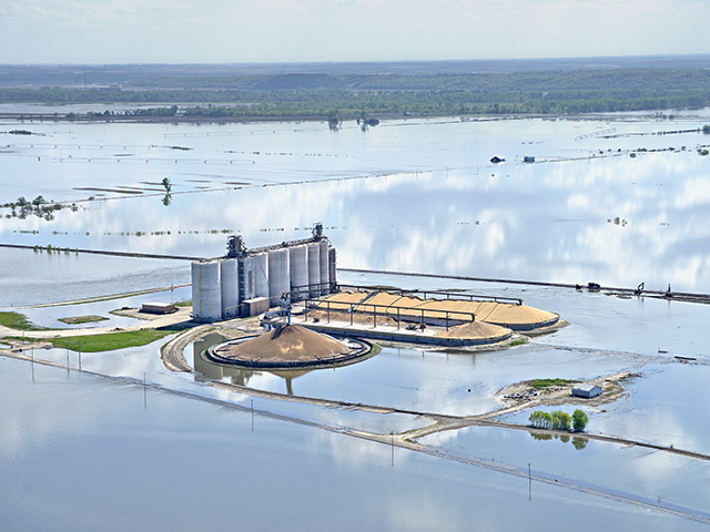 The Gavilon Grain elevator, in Rockport, Missouri, was entirely cut off by floodwaters for weeks. The grain stored outside likely was ruined, Image by Jim Patrico