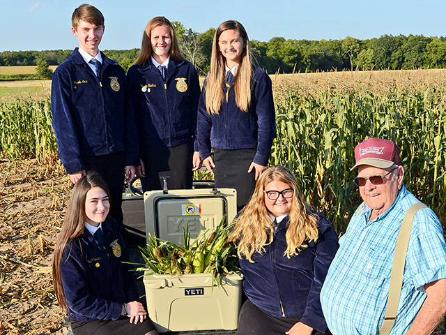 Nick Allen donates sweet corn for Troy, Missouri, FFA Chapter members to distribute to nursing homes and food pantries. From left: Lexi Collins, Emilee Harris, Jacob Love, Grace Rhodes and Kelsey Sachs , Image by Gregg Hillyer