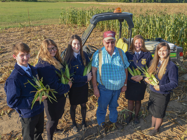 Farmer Nick Allen donates sweet corn for Troy, Missouri, FFA Chapter members to distribute to nursing homes and food pantries. Allen is shown here with (left to right) Jacob Love, Emilee Harris, Grace Rhodes, Kelsey Sachs and Lexi Collins. (Photo by Gregg Hillyer)