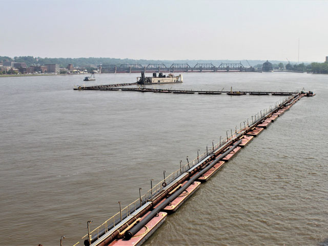 The Dredge Goetz dredges in Pool 16 on the Mississippi River. Flooding turned the Mississippi River into a sandbox after sand and silt were deposited by strong currents and rushing waters created by the barrage of flooding on the entire system. But it will take more than a shovel and bucket to remove this sand. (Picture courtesy of USACE Rock Island.)