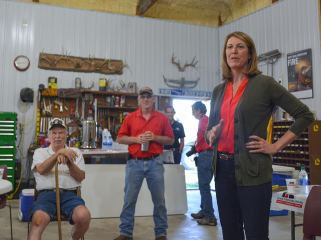 U.S. Rep. Cindy Axne, D-Iowa, talks to farmers near Emerson, Iowa, about small refinery exemptions handed out by EPA. Axne is a member on the House Agriculture Committee, but lost the rural counties in her district in 2018.